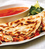 GOAT CHEESE AND BASIL PESTO QUESADILLAS WITH ROASTED RED PEPPER SAUCE