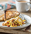 MEXICAN SCRAMBLED EGGS MADE WITH V8® SPICY HOT VEGETABLE JUICE AND PACE® SALSA