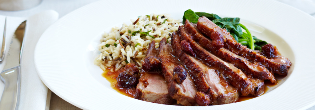 Pan seared Duck Breast with dried Cranberry Orange Reduction