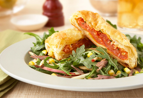 Tomato Wellingtons over Duck Confit Salad