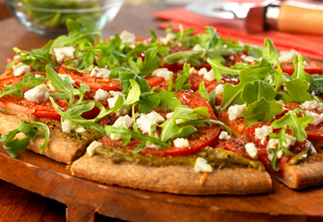 Umami-Bomb Pizza with Arugula, Heirloom Tomatoes & Goat Cheese