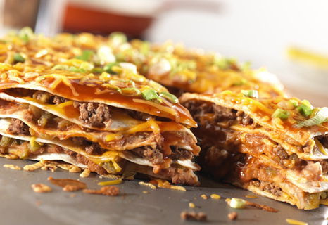 This hearty, one-dish meal features layers of ground beef, tortillas ...